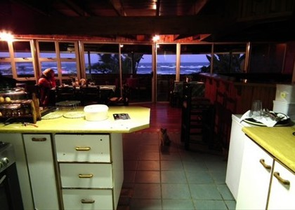 Open plan kitchen through to the dining room with ocean view